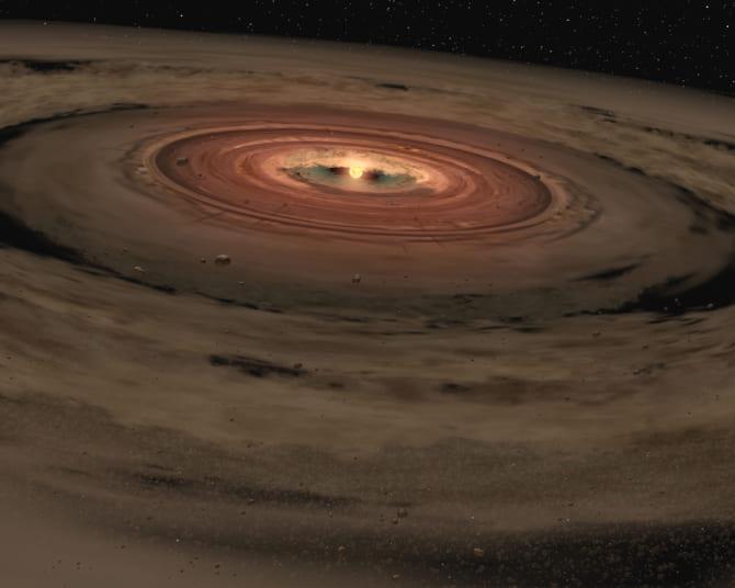 初期の星系イメージ。塵とガスによる降着円盤が原始太陽(前主系列星)を囲んでいる。