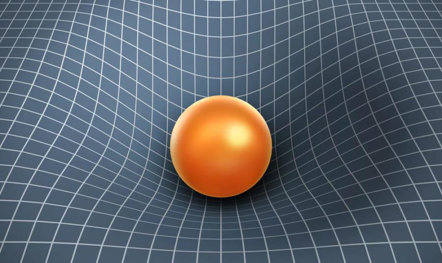 天体が持つ重力により周囲の空間は歪んでいる