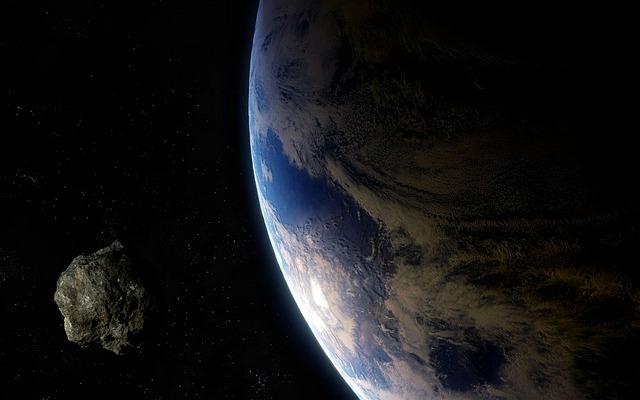 地球に接近する小惑星のイメージ。