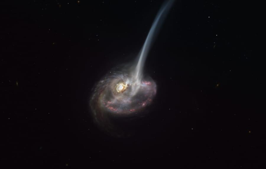 大量のガスを放出している遠方銀河「ID2299」。放出されるガスが尾のような構造を見せている。